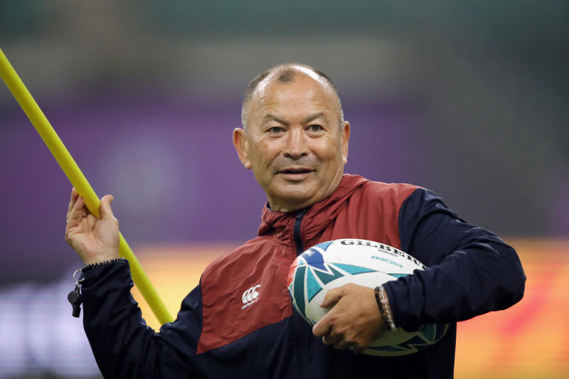 England's coach Eddie Jones throws a training pole during a training session in Oita, Japan, Friday, Oct. 18, 2019. England will face Australia in the quarterfinals at the Rugby World Cup on Oct. 19. (AP Photo/Christophe Ena)