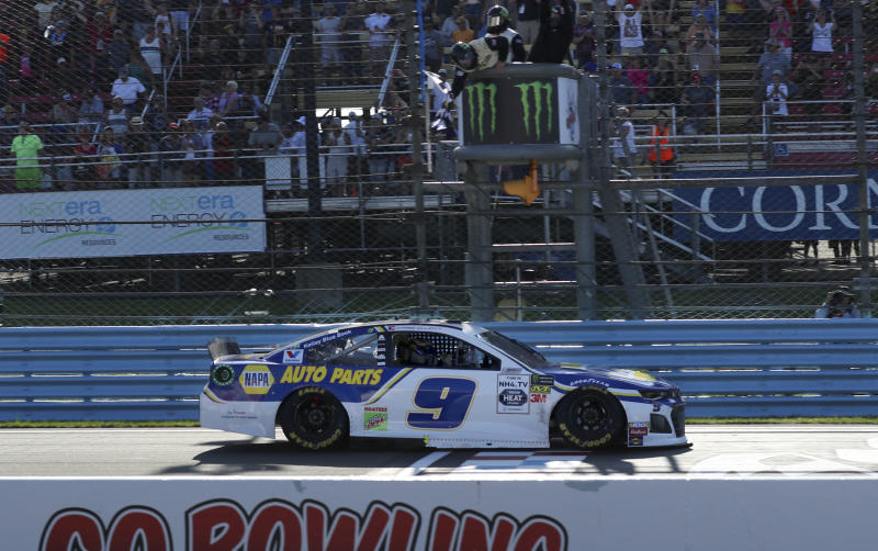 Chase Elliott crosses the finish line to win a NASCAR Cup Series auto race at Watkins Glen International, Sunday, Aug. 4, 2019, in Watkins Glen, N.Y. (AP Photo/John Munson)