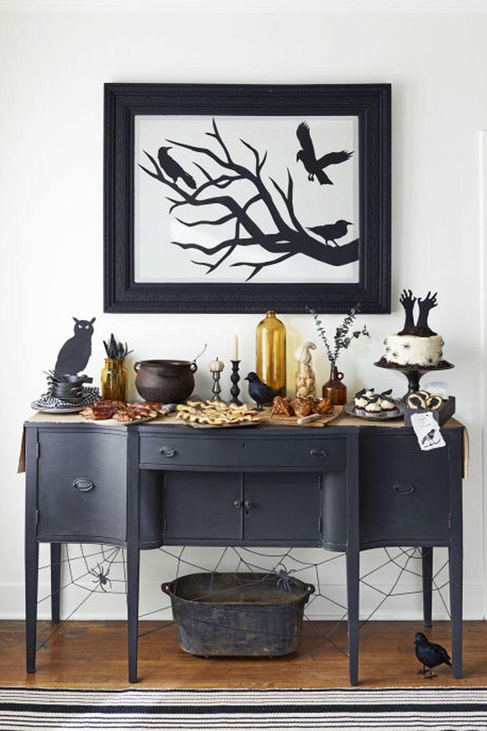 "<p>If you want to host a party that's chilling but not too scary, just throw some shade! This shadow-themed get-together has spooky silhouette cutouts of everything, from birds and bats to witches and candelabras.</p><p><strong>Find even more <a href=""https://www.countryliving.com/entertaining/g271/halloween-decorating-1005/"" rel=""nofollow noopener"" target=""_blank"" data-ylk=""slk:Halloween party decor ideas"" class=""link rapid-noclick-resp"">Halloween party decor ideas</a>.</strong> </p><p><strong><a class=""link rapid-noclick-resp"" href=""https://www.amazon.com/3-Candle-Metal-Candelabra-Black/dp/B01LY0DBDA/?tag=syn-yahoo-20&ascsubtag=%5Bartid%7C10050.g.4620%5Bsrc%7Cyahoo-us"" rel=""nofollow noopener"" target=""_blank"" data-ylk=""slk:SHOP BLACK CANDELABRAS"">SHOP BLACK CANDELABRAS</a></strong></p>"