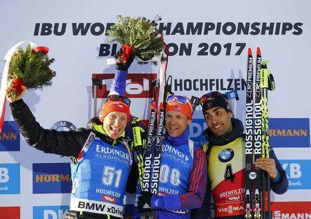 Biathlon - IBU World Championships - Men's 15km Individual - Hochfilzen, Austria - 16/2/17 -   Ondrej Moravec of Czech Republic, Lowell Bailey from the U.S. and Martin Fourcade of France react.  REUTERS/Leonhard Foeger