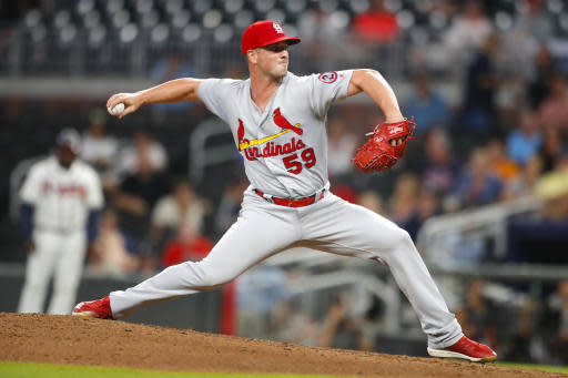 St. Louis Cardinals relief pitcher Mike Mayers delivers in the ninth inning of the team's baseball game against the Atlanta Braves, Tuesday, Sept. 18, 2018, in Atlanta. The Cardinals won 8-1. (AP Photo/Todd Kirkland)