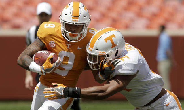 Orange team running back Tim Jordan (9) is tackled by White team linebacker Quart'e Sapp (14) during the Orange and White spring game at Neyland Stadium on Saturday, April 21, 2018 in Knoxville, Tenn. (C.B. Schmelter /Chattanooga Times Free Press via AP)
