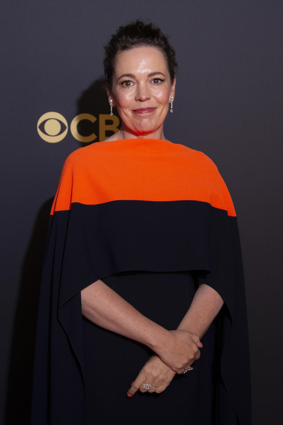Olivia Colman poses for photographers as she arrives for the Netflix Celebration of the 73rd Primetime Emmy Awards in central London on Sept. 19, 2021. - Credit: Joel C Ryan/Invision/AP