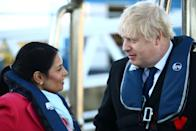 SOUTHAMPTON, ENGLAND - DECEMBER 2: Britain's Prime Minister Boris Johnson speaks with Home Secretary, Priti Patel aboard a security vessel at the Port of Southampton, Britain December 2, 2019. (Photo by Hannah McKay - WPA Pool/Getty Images)
