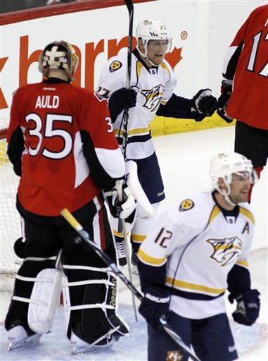 Ottawa Senators goaltender Alex Auld (35) looks on as Nashville Predators' Patric Hornqvist and teammate Mike Fisher (12) celebrate Hornqvist's goal during second-period NHL hockey action in Ottawa, Ontario, Thursday, Feb. 9, 2012. (AP Photo/The Canadian Press, Fred Chartrand)