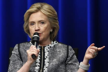 Clinton participates in an event on empowering woman and girls, at the World Bank in Washington