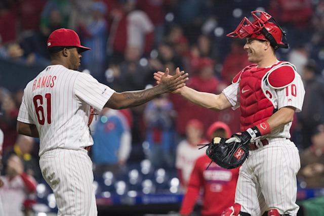May 1, 2019; Philadelphia, PA, USA; Philadelphia Phillies relief pitcher Edubray Ramos (61) and catcher J.T. Realmuto (10) celebrate after defeating the Detroit Tigers at Citizens Bank Park. Mandatory Credit: Bill Streicher-USA TODAY Sports