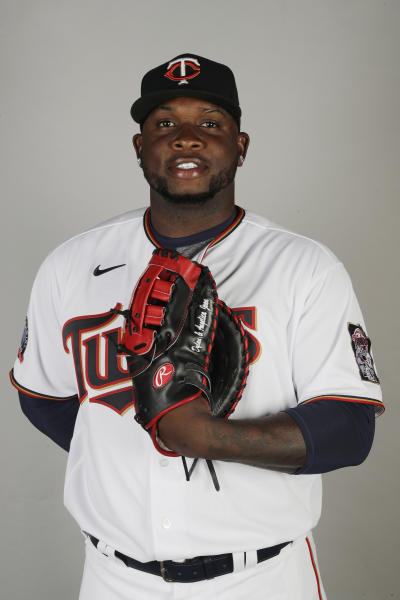 FILE - In this Feb. 20, 2020 file photo, Miguel Sano of the Minnesota Twins poses for a photo in Fort Myers, Fl. Authorities in the Dominican Republic opened an investigation on Thursday, June 25, 2020, into allegations the first baseman participated in the kidnapping and beating of a man in his homeland. Sano, who signed a three-year, $30 million contract with the Twins in January, denies the allegation and has said he's being blackmailed.  (AP Photo/Brynn Anderson, File)