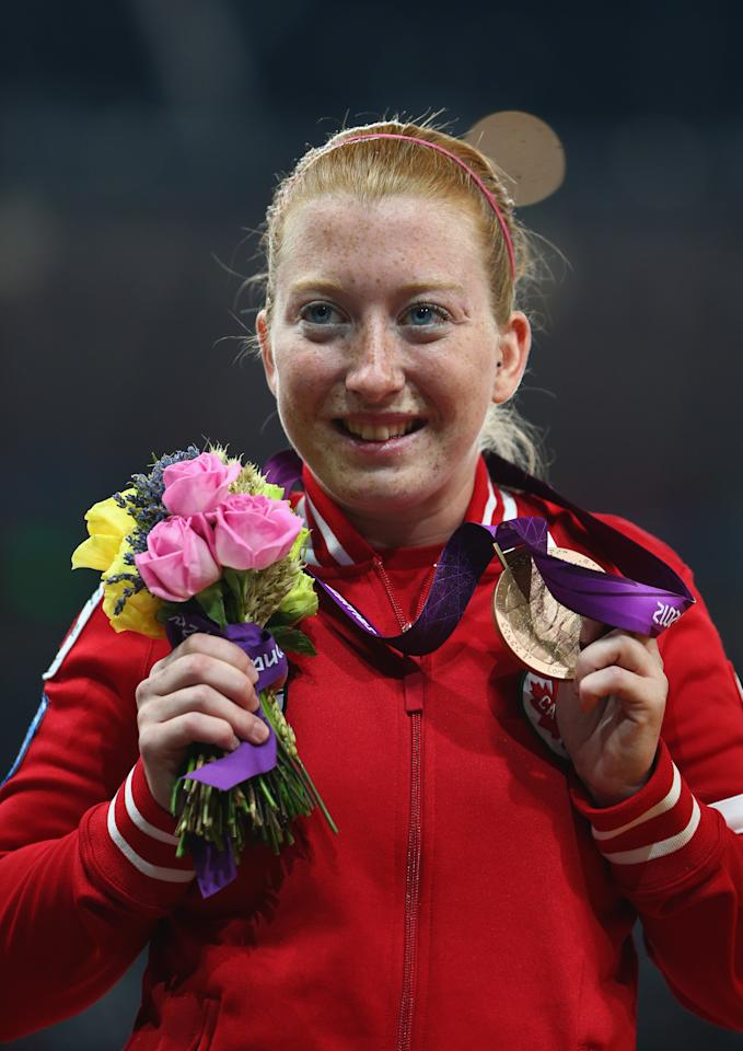 LONDON, ENGLAND - AUGUST 31: Bronze medalist Virginia Mclachlan of Canada poses on the podium during the medal ceremony in the Women's 200m - T35 Final on day 2 of the London 2012 Paralympic Games at Olympic Stadium on August 31, 2012 in London, England. (Photo by Michael Steele/Getty Images)