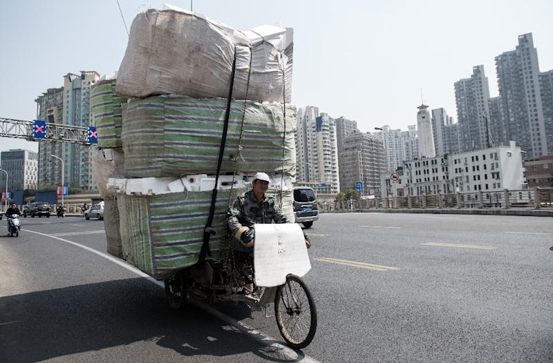 Paper, plastic and textiles are among the 24 categories of solid waste that have been banned by a new Chinese rule (AFP Photo/JOHANNES EISELE)