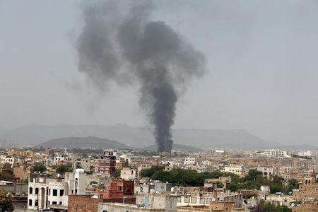 Smoke rises from a snack food factory after a Saudi-led air strike hit it in Sanaa