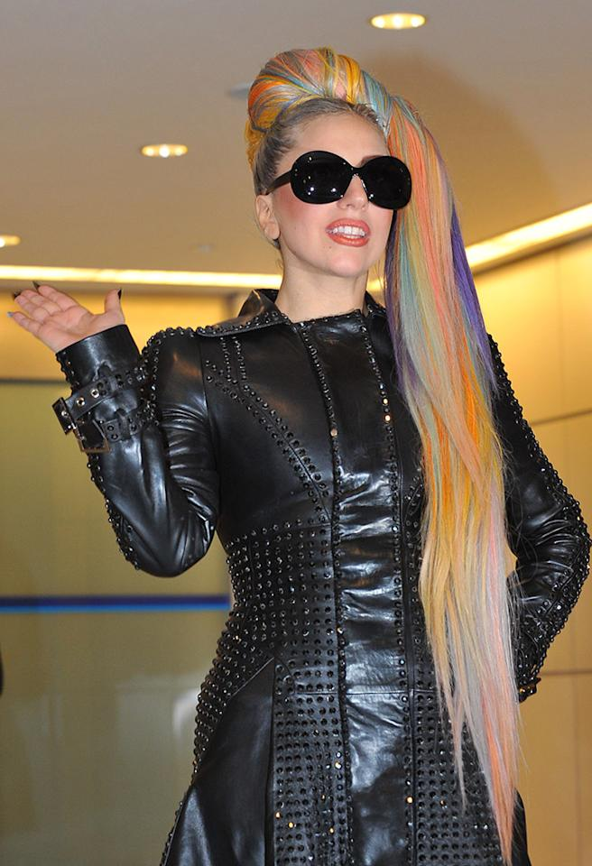"""Lady Gaga, sporting a leather coat and her rainbow-colored hair, arrives at Narita Airport, east of Tokyo. The American pop singer and song writer was in Japan on a """"Lady Gaga/The Born This Way Ball"""" world tour. It was her sixth visit to Japan, where a teacup and saucer, marked with her lipstick and bearing the Japanese message 'We pray for Japan' along with the stars autograph, has fetched more than $75,000 at auction. Pictured: Lady Gaga  Ref: SPL382753  080512  Picture by: Aflo / Splash News   Splash News and Pictures Los Angeles:310-821-2666 New York:212-619-2666 London:870-934-2666 photodesk@splashnews.com"""