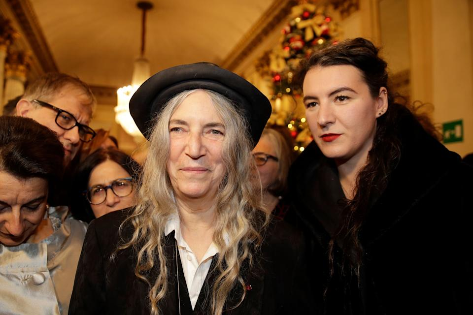 """Musician Patti Smith arrives with her daughter Jesse Smith, right, for the gala premiere of La Scala opera house, in Milan, Italy, Saturday, Dec. 7, 2019. Milan's storied La Scala opens its 2019-2020 season on Saturday with Puccini's """"Tosca,"""" which stars Russian soprano Anna Netrebko as the object of unwanted sexual attention from a powerful authority figure. (AP Photo/Luca Bruno) (Photo: ASSOCIATED PRESS)"""