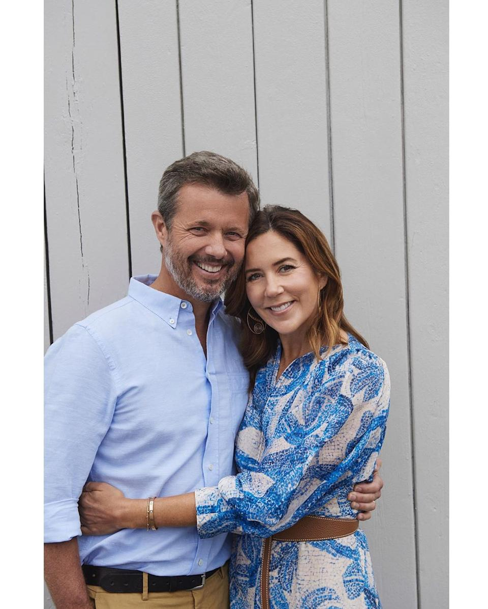 Princess Mary and Prince Frederik hugging and smiling