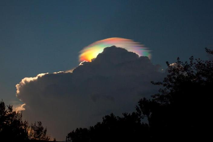 """A pileus iridescent cloud was captured by photographer Esther Havens in Ethiopia. According to NASA this phenomenon is a result of """"a group of water droplets that have a uniformly similar size and so together diffract different colors of sunlight by different amounts"""".<br><br>See more of Esther Haven's images at <a href=""""http://www.estherhavens.com"""" rel=""""nofollow noopener"""" target=""""_blank"""" data-ylk=""""slk:estherhavens.com"""" class=""""link rapid-noclick-resp"""">estherhavens.com </a><br><br>(Photo: Esther Havens)"""