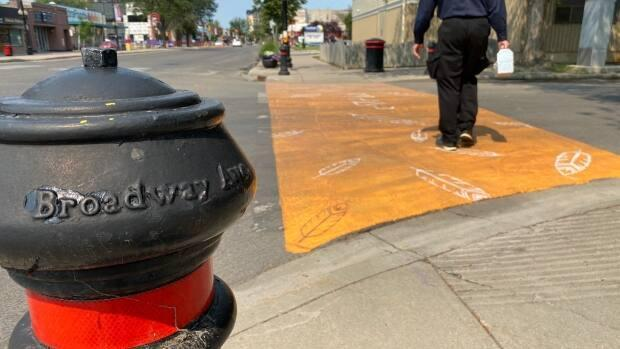 One of the crosswalks that Saskatoon non-profit Chokecherry Studios painted in honour of children who died at residential schools. (Don Somers/CBC - image credit)