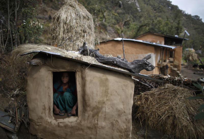 Uttara Saud, 14, sits inside a Chaupadi shed in the hills of Legudsen village in Achham District in western Nepal February 16, 2014. Chaupadi is a tradition observed in parts of Nepal, which cuts women off from the rest of society when they are menstruating. Women who practice traditional chaupadi have to sleep in sheds or outbuildings while they are on their period, often with little protection from the elements. They are not allowed to enter houses or temples, use normal public water sources, take part in festivals or touch others during their menstruation, according to a United Nations field bulletin on the issue. Isolated in sheds that are frequently rickety and unhygienic, there have been cases of women dying while practicing chaupadi from illness, exposure, animal attacks or from fires lit in poorly ventilated spaces. Chaupadi was banned by Nepal's Supreme Court in 2005, but it is still common in the country's far and mid-western regions. Picture taken February 16, 2014. REUTERS/Navesh Chitrakar (NEPAL - Tags: SOCIETY TPX IMAGES OF THE DAY) ATTENTION EDITORS: PICTURE 09 OF 20 FOR PACKAGE 'BANISHED ONCE A MONTH' TO FIND ALL IMAGES SEARCH 'CHAUPADI'