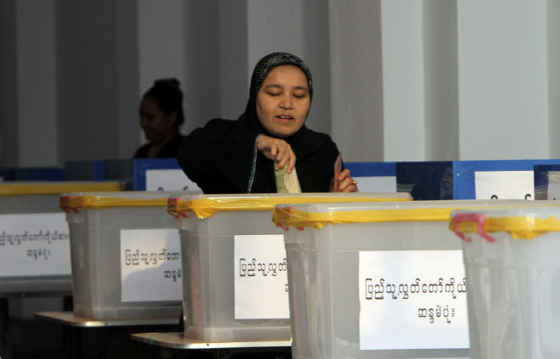 A Myanmar-Muslim woman casts her vote at a polling station in Yangon, Myanmar, Sunday, April. 1, 2012. Myanmar held a landmark election Sunday that was expected to send democracy icon Aung San Suu Kyi into parliament for her first public office since launching her decades-long struggle against the military-dominated government. (AP Photo/Khin Maung Win)