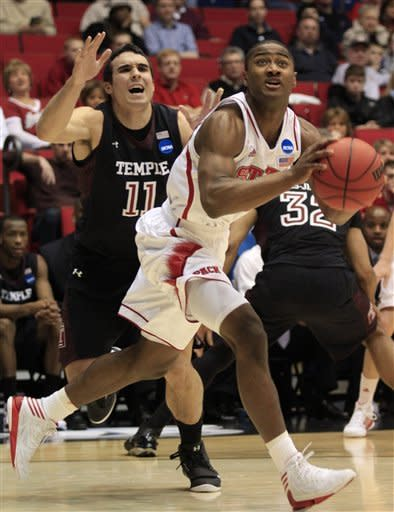 North Carolina State guard Rodney Purvis drives past Temple guard T.J. DiLeo (11) in the first half of a second-round game at the NCAA college basketball tournament, Friday, March 22, 2013, in Dayton, Ohio. (AP Photo/Al Behrman)