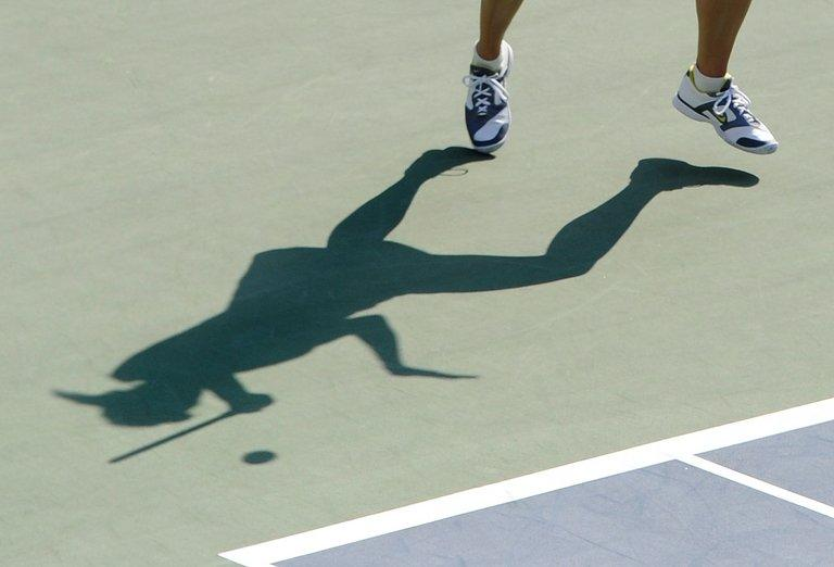 A shadow shows Maria Sharapova of Russia during the Pan Pacific Open tennis tournament in Tokyo on September 28, 2011