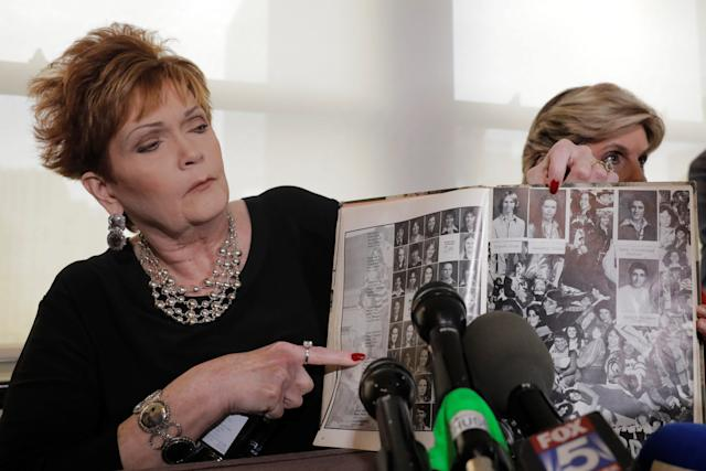 Beverly Young Nelson points to a photograph of herself in her high school yearbook after claiming that Moore sexually harassed her when she was 16. She made the allegation at a press conference in New York on Nov. 13. (Lucas Jackson / Reuters)