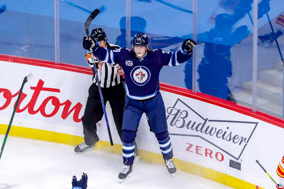 WINNIPEG, MB - JANUARY 14: Patrik Laine #29 of the Winnipeg Jets celebrates after scoring the overtime winner for a 4-3 victory over the Calgary Flames at the Bell MTS Place on January 14, 2021 in Winnipeg, Manitoba, Canada. (Photo by Darcy Finley/NHLI via Getty Images)