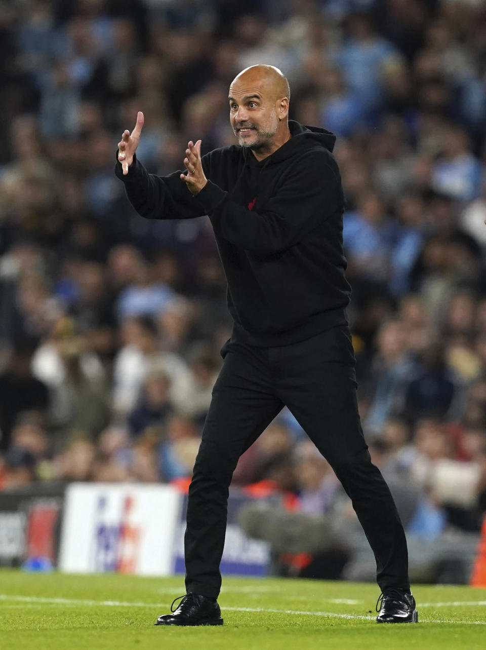 Manchester City's manager Pep Guardiola on the touchline during the Champions League Group A soccer match between Manchester City and RB Leipzig at the Etihad Stadium, Manchester, England, Wednesday Sept. 15, 2021. (Martin Rickett/PA via AP)