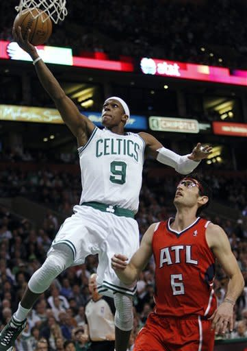 Boston Celtics' Rajon Rondo (9) shoots in front of Atlanta Hawks' Kirk Hinrich during the first quarter of Game 4 of an NBA basketball first-round playoff series, in Boston on Sunday, May 6, 2012. (AP Photo/Michael Dwyer)