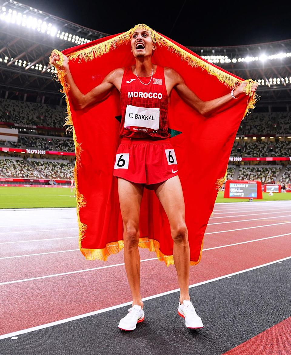 <p>Soufiane Elbakkali of Morocco wins the gold medal after the Men's 3000m Steeplechase at Olympic Stadium on August 2.</p>