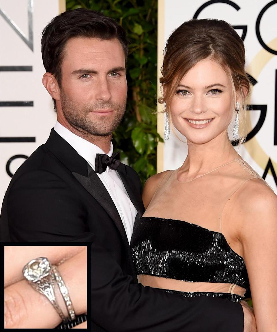 """<p>Singer Adam Levine proposed to model Behati Prinsloo with a beautiful vintage <a rel=""""nofollow noopener"""" href=""""http://www.instyle.com/news/behati-prinsloos-engagement-ring-see-photo"""" target=""""_blank"""" data-ylk=""""slk:diamond ring"""" class=""""link rapid-noclick-resp"""">diamond ring</a> in 2013. The couple <a rel=""""nofollow noopener"""" href=""""http://www.instyle.com/news/grooms-game-new-details-adam-levines-wedding"""" target=""""_blank"""" data-ylk=""""slk:wed"""" class=""""link rapid-noclick-resp"""">wed</a> in Mexico in July 2014. </p>"""