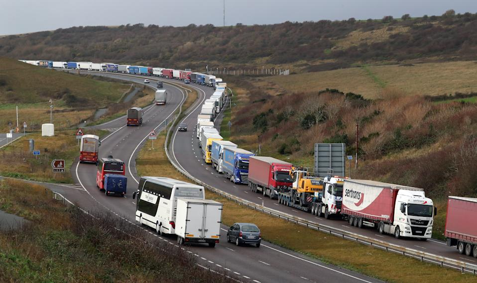 Lorries queue on the A20 to enter the port of Dover in Kent. Christmas stockpiling and Brexit uncertainty have again caused huge queues of lorries to stack up in Kent. The latest delays came as the UK marked less than two weeks until 2021 and the end of the Brexit transition period. (Photo by Gareth Fuller/PA Images via Getty Images)