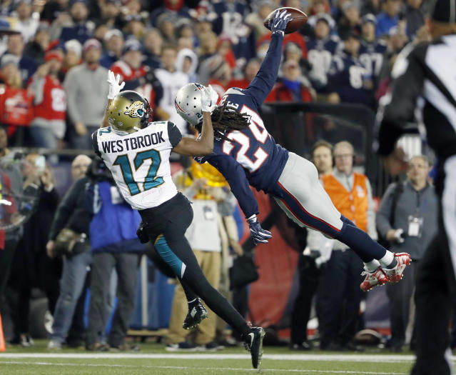 Not this time: Patriots cornerback Stephon Gilmore's diving pass break-up helped seal New England's win over Jacksonville. (AP)