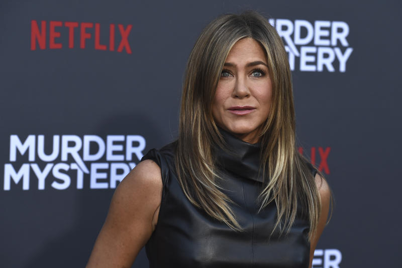 """Jennifer Aniston arrives at the Los Angeles premiere of """"Murder Mystery"""" at the Regency Village Theatre on Monday, June 10, 2019 in Westwood, Calif. (Photo by Jordan Strauss/Invision/AP)"""