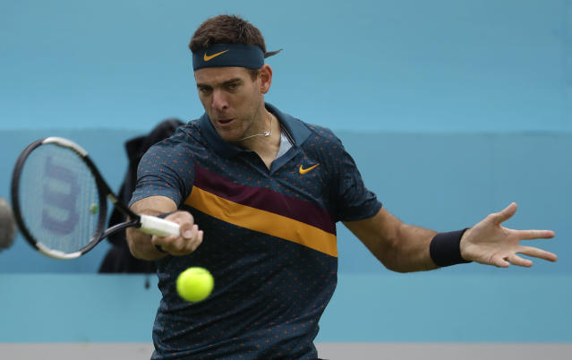 Juan Martin Del Potro of Argentina plays a return to Denis Shapovalov of Canada during the Queens Club tennis tournament in London, Wednesday, June 19, 2019. (AP Photo/Kirsty Wigglesworth)