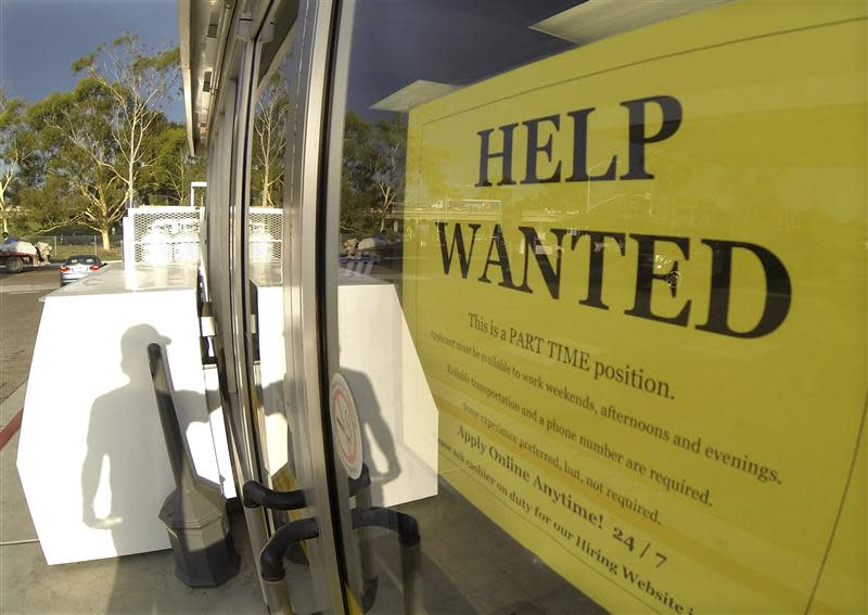 File of a help wanted sign is posted on the door of a gas station in Encinitas, California
