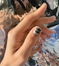 While a Chanel bag might be a bit out of budget, at least your nails can rock those iconic C's. The logo is even more luxe on a silver background.