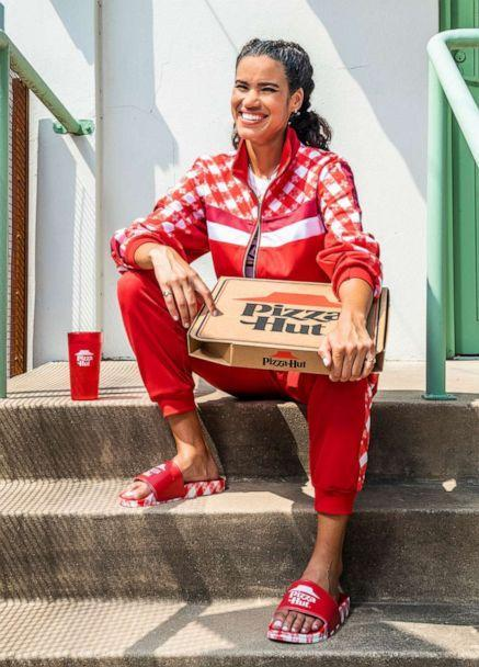 PHOTO: Model wears the Pizza Hut Tastewear track suit and slides. (Pizza Hut)