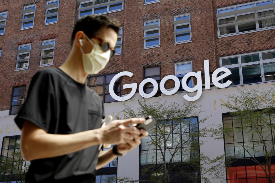 NEW YORK - NEW YORK - APRIL 13: A man checks his phone near a Google Corporate Office on April 13, 2021 in New York. More than 300 corporates including Google and Mc Donalds are pushing the Biden administration to almost double the United States target for cutting the planet warming emissions, ahead global summit on climate change in 2021. (Photo by John Smith/VIEWpress)