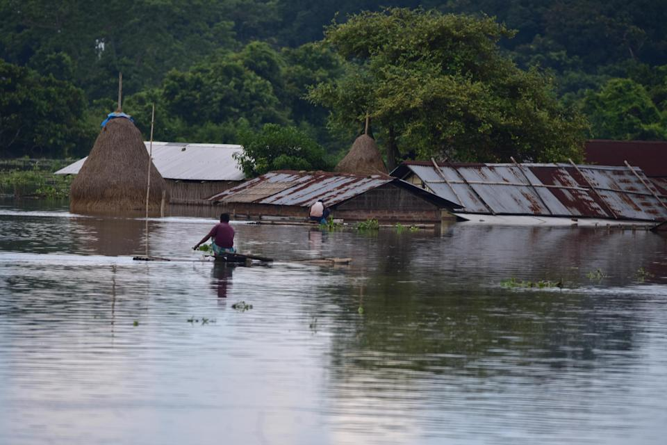 A partially submerged house at flood affected at Baghmari village near Kaziranga in Nagaon District of Assam. (Photo credit should read Anuwar Ali Hazarika/Barcroft Media via Getty Images)