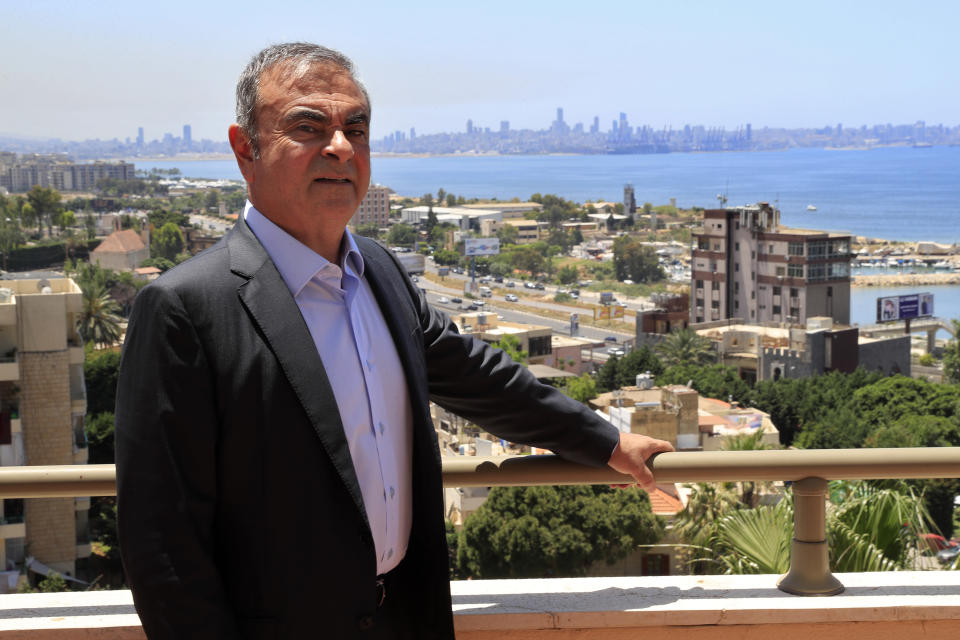Fugitive ex-auto magnate Carlos Ghosn poses for a picture during an interview with The Associated Press, in Dbayeh, north of Beirut, Lebanon, Tuesday, May 25, 2021. The embattled former chairman of the Renault-Nissan-Mitsubishi alliance dissected his legal troubles in Japan, France and the Netherlands, detailed how he plotted his brazen escape from Osaka, and reflected on his new reality in crisis-hit Lebanon, where he is stuck for the foreseeable future. (AP Photo/Hussein Malla)