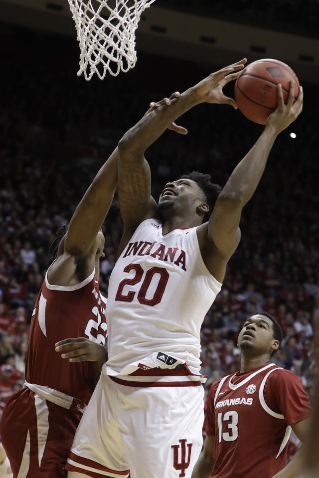Indiana's De'Ron Davis (20) is fouled by Arkansas's Gabe Osabuohien (22) as he goes up for a shot during the second half in the second round of the NIT college basketball tournament, Saturday, March 23, 2019, in Bloomington, Ind. Indiana won 63-60. (AP Photo/Darron Cummings)