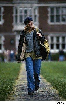 young woman walking at college with bookbags