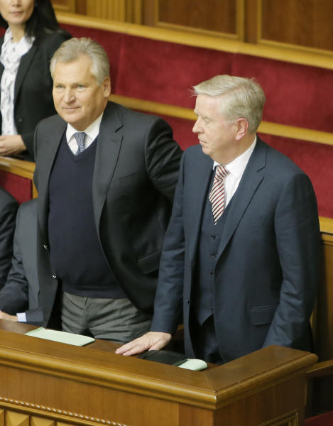 Former President of the European Parliament Patrick Cox, right, and former Polish President Aleksander Kwasniewski, watch a parliament session in Kiev, Ukraine, Wednesday, Nov. 13, 2013. A vote on various bills that would allow the release of Ukraine's jailed former premier Yulia Tymoshenko is scheduled for Wednesday. (AP Photo/Efrem Lukatsky)