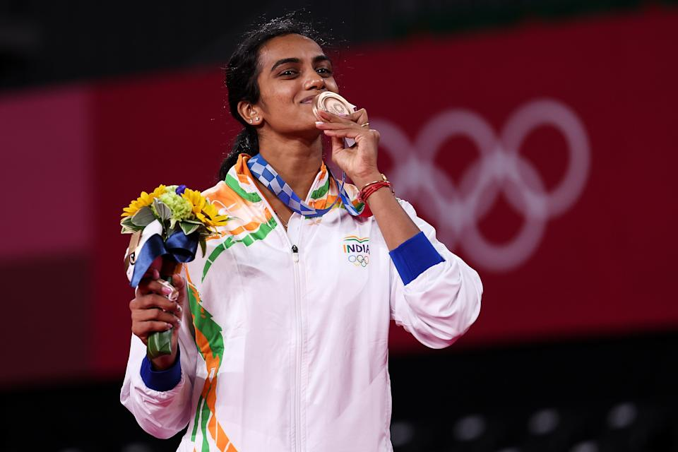 CHOFU, JAPAN - AUGUST 01: Bronze medalist Pusarla V. Sindhu of Team India poses on the podium during the medal ceremony for the Women's Singles badminton event on day nine of the Tokyo 2020 Olympic Games at Musashino Forest Sport Plaza on August 01, 2021 in Chofu, Tokyo, Japan. (Photo by Lintao Zhang/Getty Images)
