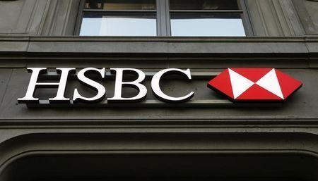 The HSBC bank logo is pictured at a branch office at the Paradeplatz in Zurich February 10, 2015. REUTERS/Arnd Wiegmann