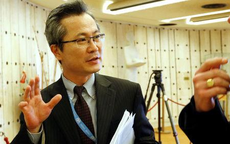 Mun, counselor at the North Korea mission to the U.N. in Geneva, talks with journalists aside of a meeting of the Human Rights Council at the United Nations in Geneva