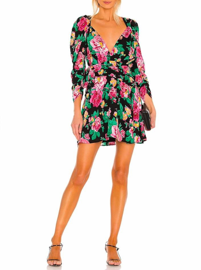 """Bright floral motifs of the '80s and '90s have been trending lately, and who wouldn't perk up looking at this fun little number? $222, Revolve. <a href=""""https://www.revolve.com/for-love-lemons-june-mini-dress/dp/FORL-WD850/?"""" rel=""""nofollow noopener"""" target=""""_blank"""" data-ylk=""""slk:Get it now!"""" class=""""link rapid-noclick-resp"""">Get it now!</a>"""