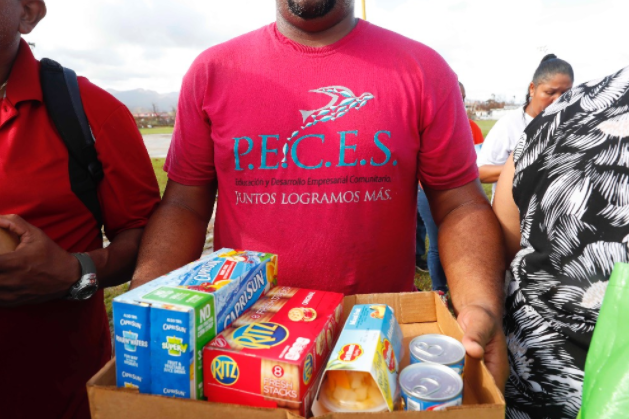 Community members with nonprofit P.E.C.E.S. in Humacao, Puerto Rico, help provide aid after the hurricane -- and look toward building a more sustainable future (Dayani Centeno Torres)