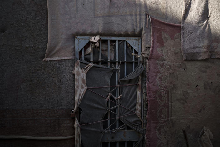 A cell used for conjugal visit remains locked at an abandoned area of the Pul-e-Charkhi prison in Kabul, Afghanistan, Monday, Sept. 13, 2021. When the Taliban took control of a northern Afghan city of Pul-e-Kumri the operator of the only women's shelter ran away, abandoning 20 women in it. When the Taliban arrived at the shelter the women were given two choices: Return to their abusive families, or go with the Taliban, With nowhere to put the women, the Taliban took them to the abandoned women's section of Afghanistan's notorious Pul-e-Charkhi prison. (AP Photo/Felipe Dana)