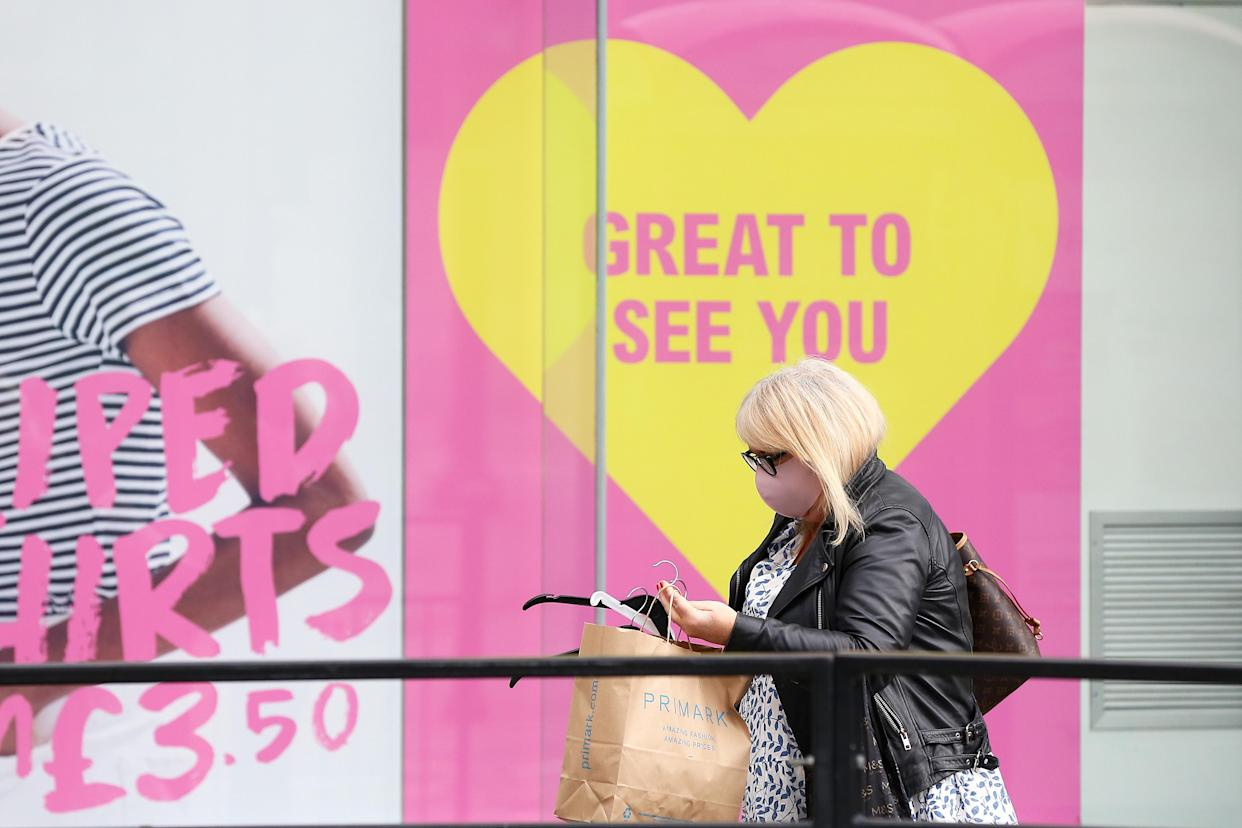 MANCHESTER, UNITED KINGDOM - MAY 13: A woman is seen wearing a face mask outside non-essential retail store Primark on May 13, 2021 in Manchester, United Kingdom. (Photo by Charlotte Tattersall/Getty Images)